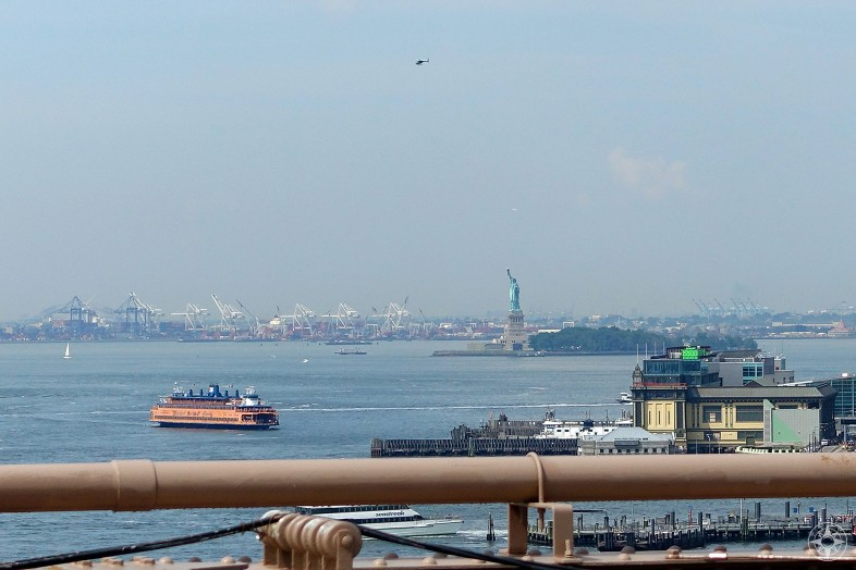 Brooklyn Bridge view of the Staten Island Ferry, Statue of Liberty, harbor, New Jersey