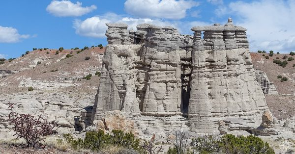Towering rock formations of Plaza Blanca, a place frequently painted by Georgia O'Keeffe - and a stop on our road trip to New Mexico sights that inspired Ansel Adams and O'Keeffe.