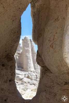 A natural rock formation frames more white rock pillars against in the valley Georgia O'Keeffe called The White Place aka Plaza Blanca. Access via dirt road on the private land of the Dar Al Islam Center, New Mexico.