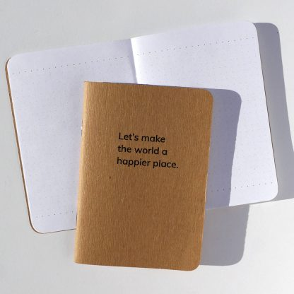 Let's make the world a happier place pocket-sized dot-grid Notebook by Happier Place made sustainably with recycled paper and plant-based ink.