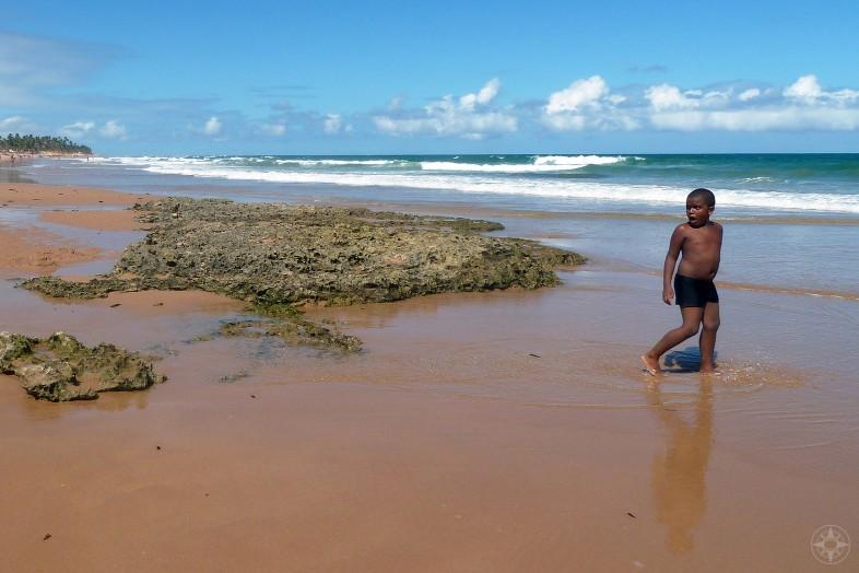 Black boy on the beach, reflection, Brazil