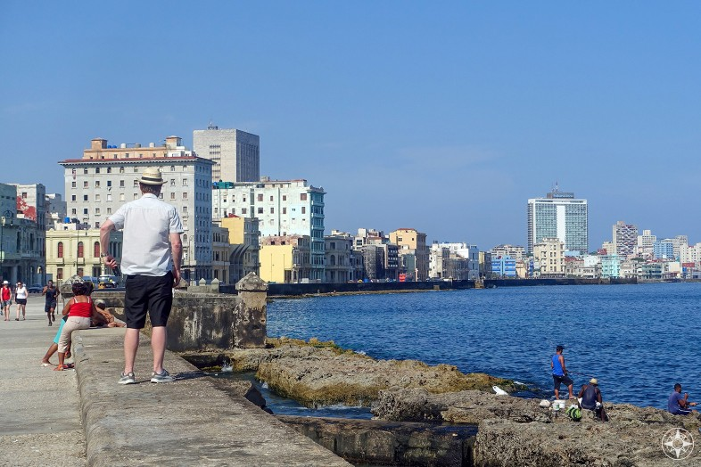 people on the Malecon, sidewalk, new and old sewall, fishing, building, Habana Libre