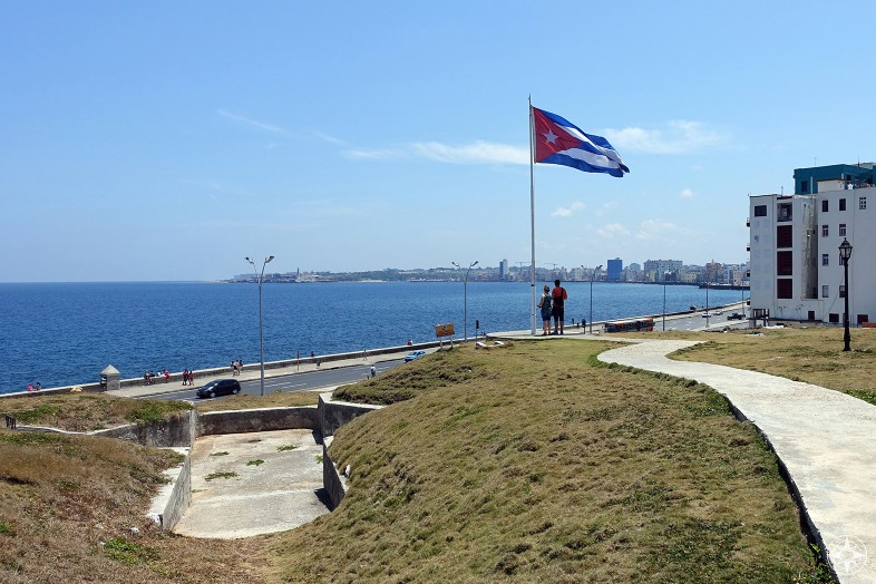 View of the Cuban flag, bunker entrance, the Malecón, and Bay of Havana from the famous Hotel Nacional