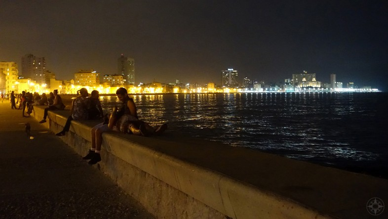 Late-night rendezvous on the famous Malecón seawall along the northside of Havana, Cuba