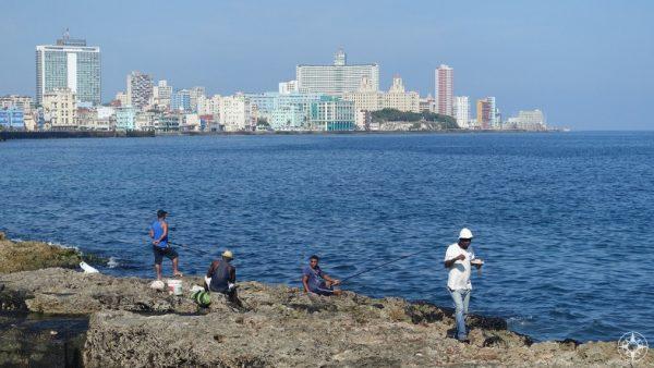 fishing and eating on the old seawall, Malecon, Havana, skyline, Habana Libre, Hotel Nacional