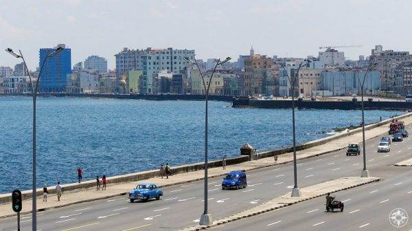 The Malecón roadway, esplanade and seawall as it bends along the old center of Havana