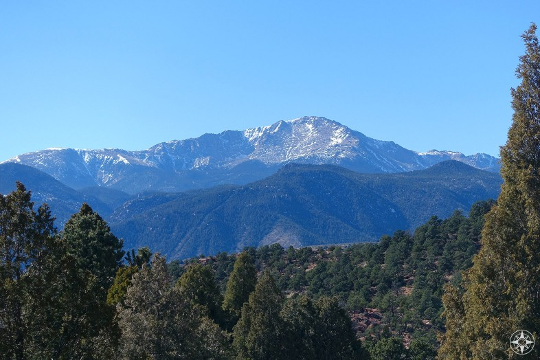 America's Mountain: Pikes Peak rises above the woods surrounding Garden of the Gods and Colorado Springs in the Colorado Rocky Mountains