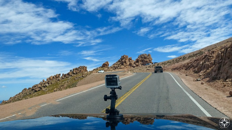 GoPro camera on car hood driving up mountain