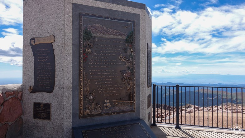 Monument with America the Beautiful lyrics by Katharine Lee Bates on the top of Pikes Peak with the views that inspired the song
