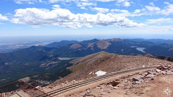 View from Pikes Peak shows the curve of planet Earth and cog trail tracks.