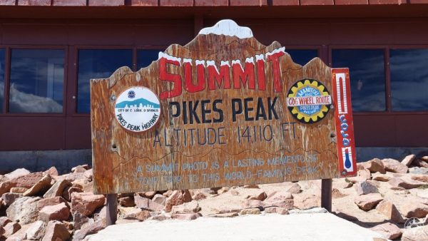 You made it! You're at the 14,110 foot summit - you might as well take a photo. Turns out a photo is a lasting memory.