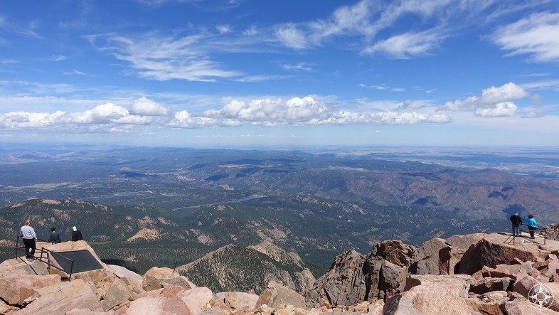 People take in view from Pikes Peak Summit, America's Mountain, Colorado