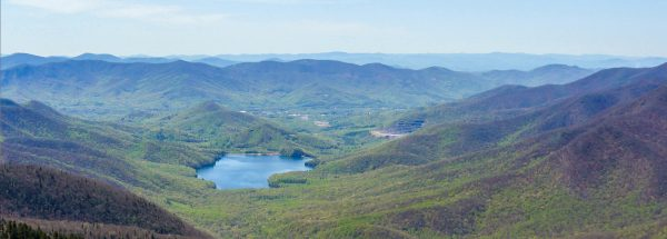Happier Place, blue valley lake among green hills, seen from Blue Ridge Parkway, North Carolina