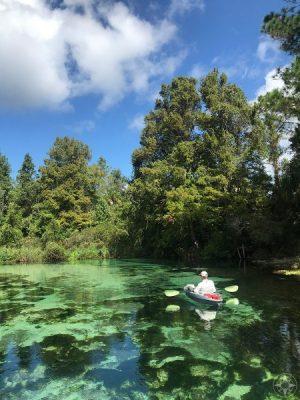 Kayak floating down crystal-clear Weeki Wachee River, Florida