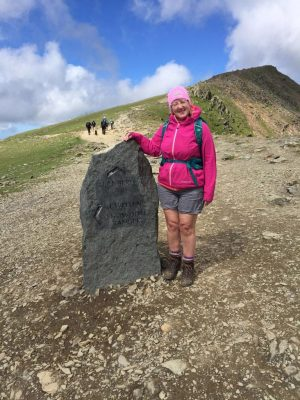 Female hiker, authors mother, stone trail sign and summit marker, Snowdon Mountain, Snowdonia, Wales, Mountains of Britain