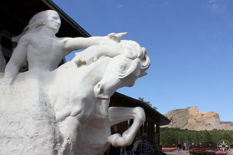 Scaled down sculpture of Crazy Horse on his horse by Korczak Ziolkowski and the actual mountain monument still in progress
