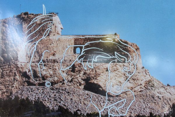 Drawing on a photo showing the planned outlines of Crazy Horse Memorial