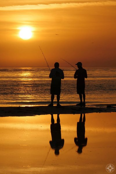 Men fishing, sunset, silhouette, reflection, dog beach, Honeymoon Island, Florida