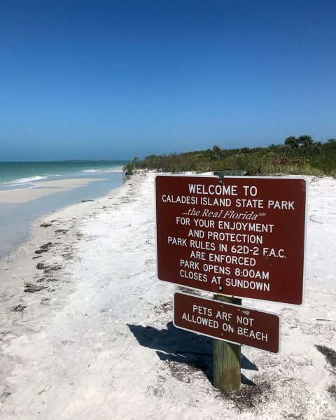 Caladesi Island State Park sign on the beach walking up from Clearwater Beach