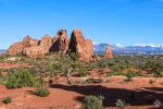National Park Week at Arches National Park in Moab, Utah, red rock formations against snow-covered peaks and blue sky