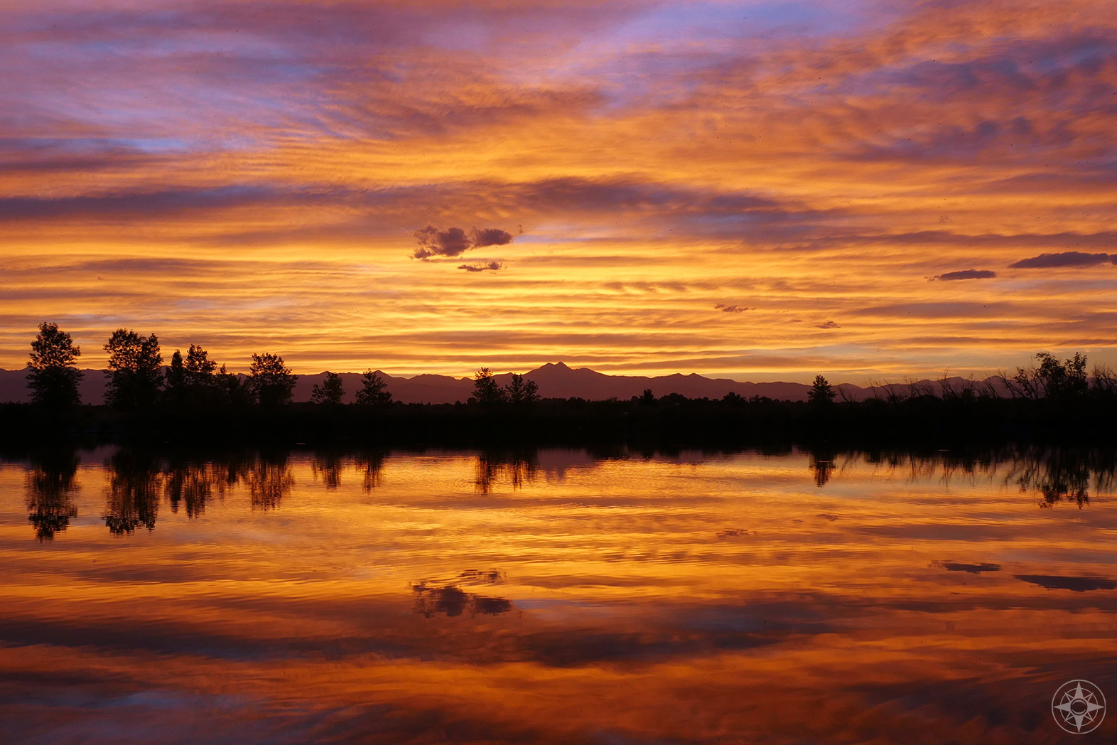 Rocky Mountain Sunset Reflection in Coot Pond in St. Vrain State Park, Colorado