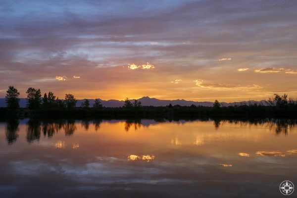 Twilight dusk sunset and Rocky Mountains reflection in Saint Vrain State Park Pond