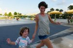 Mother and daughter laughing, running, St Pete Pier water park, Take a Break. Go outside. Have fun. first Happier Place Tank Top, cotton, racerback, titanium grey