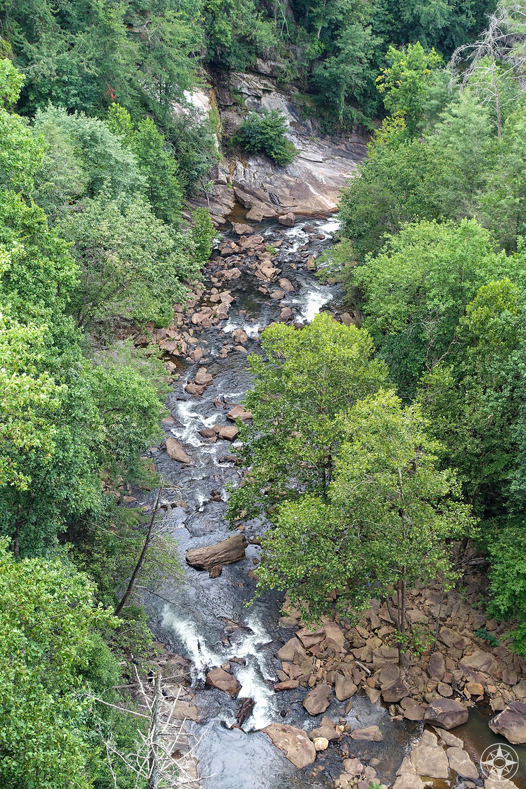 View down to the Tallulah River from the top of the dam and sidewalk along Highway 23